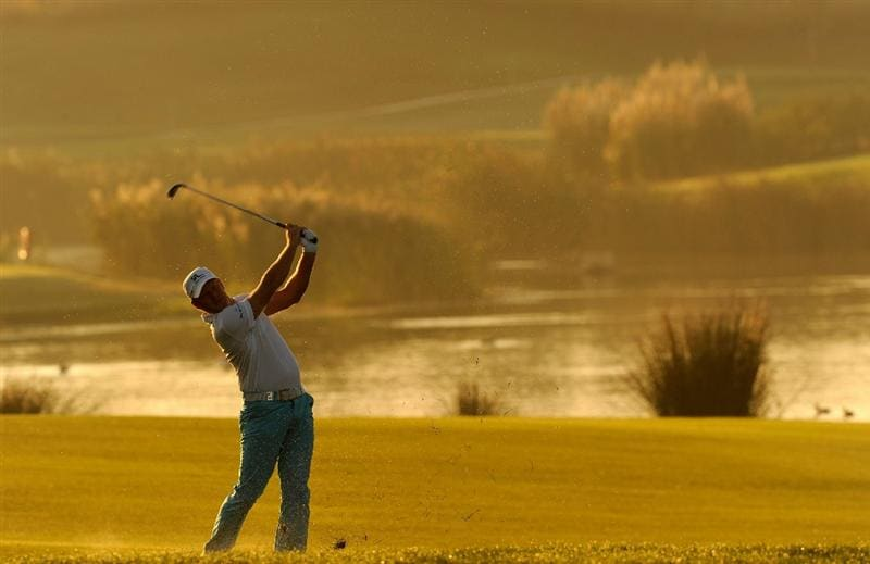 VILLAMOURA, PORTUGAL - OCTOBER 15:  Jamie Donaldson of Wales plays his approach shot on the 11th hole during the second round of the Portugal Masters at the Oceanico Victoria Golf Course on October 15, 2010 in Villamoura, Portugal.  (Photo by Stuart Franklin/Getty Images)