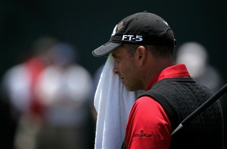 SAN DIEGO - JUNE 16:  Rocco Mediate employs a towel to wipe his face on the 18th green during the playoff round of the 108th U.S. Open at the Torrey Pines Golf Course (South Course) on June 16, 2008 in San Diego, California.  (Photo by Doug Pensinger/Getty Images)