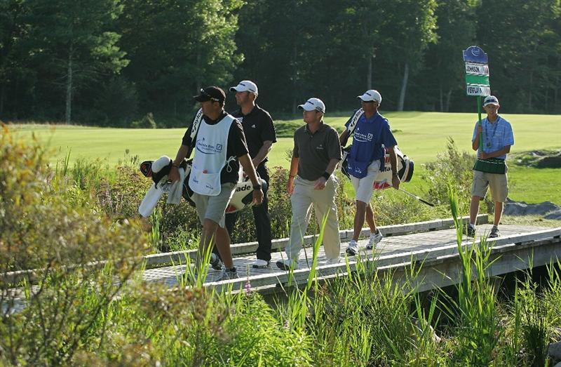 NORTON, MA - SEPTEMBER 06:  Dustin Johnson (L) and Scott Verplank cross the bridge to the 18th green during the third round of the Deutsche Bank Championship at TPC Boston held on September 6, 2009 in Norton, Massachusetts.  (Photo by Michael Cohen/Getty Images)