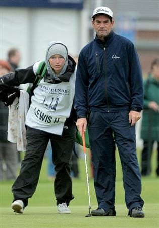 CARNOUSTIE, SCOTLAND - OCTOBER 09:  Singer  Huey Lewis with his caddie during the third round of The Alfred Dunhill Links Championship at the Carnoustie Golf Links on October 9, 2010 in Carnoustie, Scotland.  (Photo by David Cannon/Getty Images)