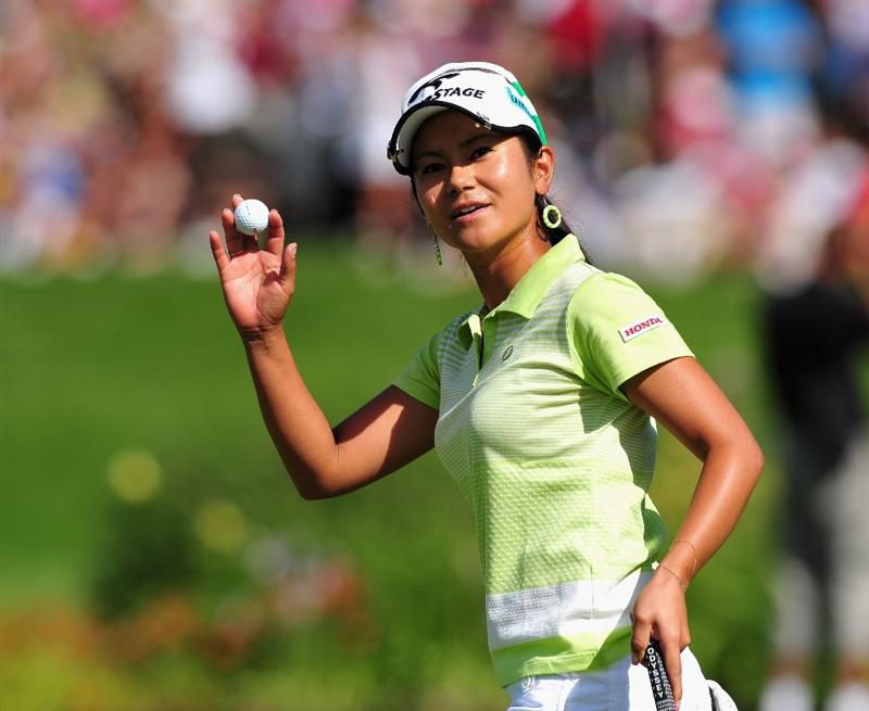 EVIAN-LES-BAINS, FRANCE - JULY 25: Ai Miyyazato of Japan celebrates her putt on the 18th hole during the third round of the Evian Masters at the Evian Masters Golf Club on July 25, 2009 in Evian-les-Bains, France.  (Photo by Stuart Franklin/Getty Images)