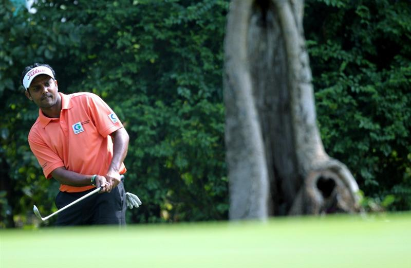 HONG KONG - NOVEMBER 19:  SSP Chowrasia of India plays out of the rough on the 6th hole during day two of the UBS Hong Kong Open at The Hong Kong Golf Club on November 19, 2010 in Hong Kong, Hong Kong.  (Photo by Stanley Chou/Getty Images)