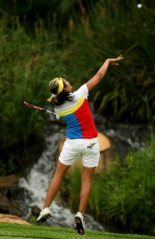 SUN CITY, SOUTH AFRICA - JANUARY 20:  Jennifer Rosales of The Philippines celebrates victory on the 18th green during the final round of the Women's World Cup of Golf at The Gary Player Country Club on January 20, 2008 in Sun City, South Africa.  (Photo by Richard Heathcote/Getty Images)