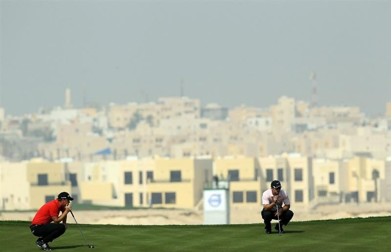 BAHRAIN, BAHRAIN - JANUARY 30:  Paul Casey of England and his playing partner Peter Hanson of Sweden on the green at the 2nd hole during the final round of the 2011 Volvo Champions held at the Royal Golf Club on January 30, 2011 in Bahrain, Bahrain.  (Photo by David Cannon/Getty Images)