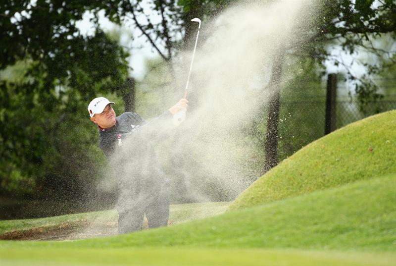 VIRGINIA WATER, ENGLAND - MAY 26:   Paul Lawrie of Scotland plays a bunker shot during the first round of the BMW PGA Championship at Wentworth Club on May 26, 2011 in Virginia Water, England.  (Photo by Richard Heathcote/Getty Images)