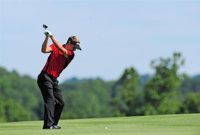 AKRON, OH - AUGUST 06:  Luke Donald of England plays his approach shot on the 16th hole during the first round of the World Golf Championship Bridgestone Invitational on August 6, 2009 at Firestone Country Club in Akron, Ohio.  (Photo by Stuart Franklin/Getty Images)