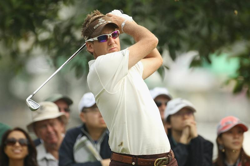 HONG KONG - NOVEMBER 18:  Ian Poulter of England  looks on after playing an approach shot during day one of the UBS Hong Kong Open at The Hong Kong Golf Club on November 18, 2010 in Hong Kong, Hong Kong.  (Photo by Ian Walton/Getty Images)