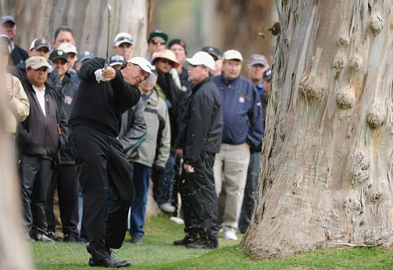 PACIFIC PALISADES, CA - FEBRUARY 18:  Phil Mickelson plays his approach shot on the 13th hole during the second round of the Northern Trust Open at Riviera Country Club on February 18, 2011 in Pacific Palisades, California.  (Photo by Stuart Franklin/Getty Images)