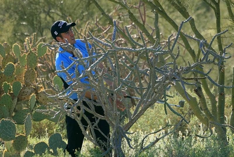 MARANA, AZ - FEBRUARY 28:  Ross Fisher of England watches a shot from the desert rough on the 14th hole during the semifinals of the Accenture Match Play Championship at the Ritz-Carlton Golf Club at Dove Mountain on February 28, 2009 in Marana, Arizona.  (Photo by Scott Halleran/Getty Images)