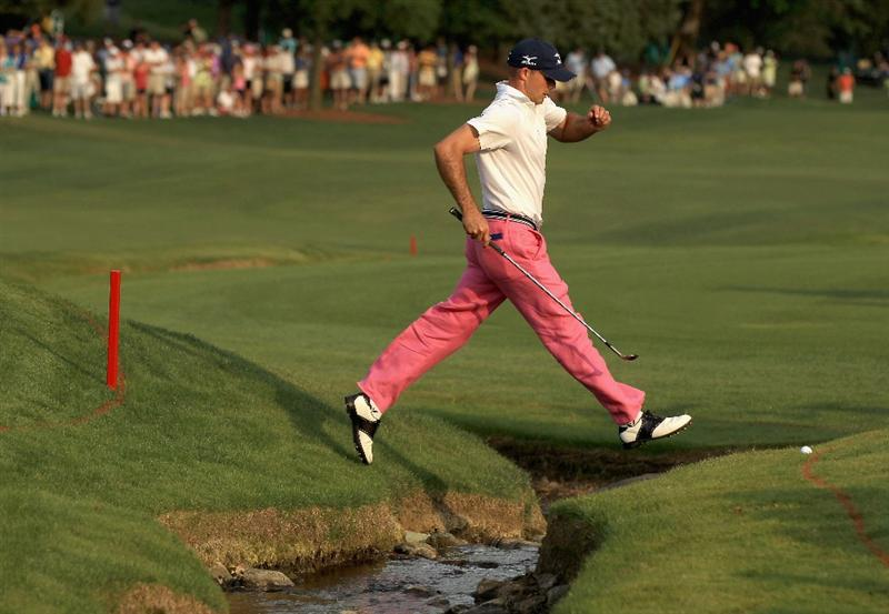 CHARLOTTE, NC - MAY 08:  Jonathan Byrd jumps over creek on the 18th hole during the final round of the Wells Fargo Championship at Quail Hollow Club on May 8, 2011 in Charlotte, North Carolina.  (Photo by Streeter Lecka/Getty Images)