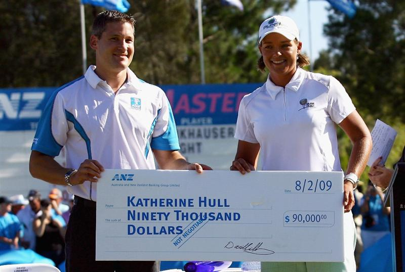 BRISBANE, AUSTRALIA - FEBRUARY 08: Katherine Hull of Australia is presented with the winners cheque after winning the 2009 ANZ Ladies Masters at Royal Pines Resort on February 8, 2009 in Brisbane, Australia.  (Photo by Bradley Kanaris/Getty Images)