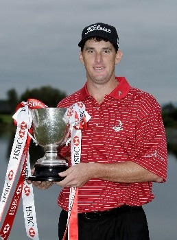 CHRISTCHURCH, NEW ZEALAND - FEBRUARY 17:  Darron Stiles of the USA poses with the  trophy after his victory on the final day of the NZPGA Championship at Clearwater Golf Club on February 17, 2008 in Christchurch, New Zealand.  (Photo by Robert Cianflone/Getty Images)