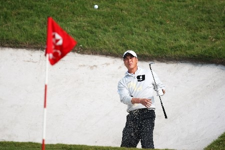 SHANGHAI, CHINA - NOVEMBER 09:  Lian-wei Zhang of China plays out the bunker on the 8th  during Day 2 of the HSBC Champions at the Sheshan Golf Club on November 9, 2007 in Shanghai, China.  (Photo by Ross Kinnaird/Getty Images)