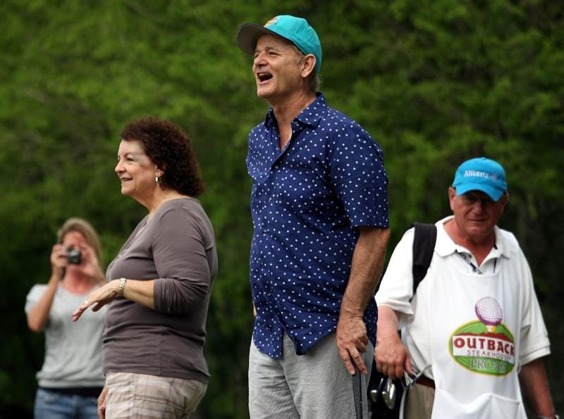 LUTZ, FL - APRIL 19: Actor Bill Murray (C) jokes with spectator Gail DiMaggio (L) on the ninth hole during the final round of the Outback Steakhouse Pro-Am at TPC Tampa Bay on April 19, 2009  in Lutz, Florida. Murray's tee shot struck DiMaggio in the head on the same hole while she was standing in her back yard during the first round of play on Friday. DiMaggio was taken to the hospital, but she was released the same day. (Photo by Marc Serota/Getty Images)