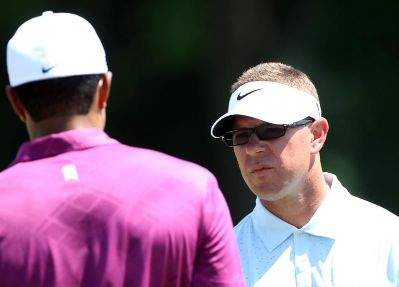 ORLANDO, FL - MARCH 26:  Swing coach Sean Foley talks with Tiger Woods prior to the third round of the Arnold Palmer Invitational presented by MasterCard at the Bay Hill Club and Lodge on March 26, 2011 in Orlando, Florida.  (Photo by Sam Greenwood/Getty Images)