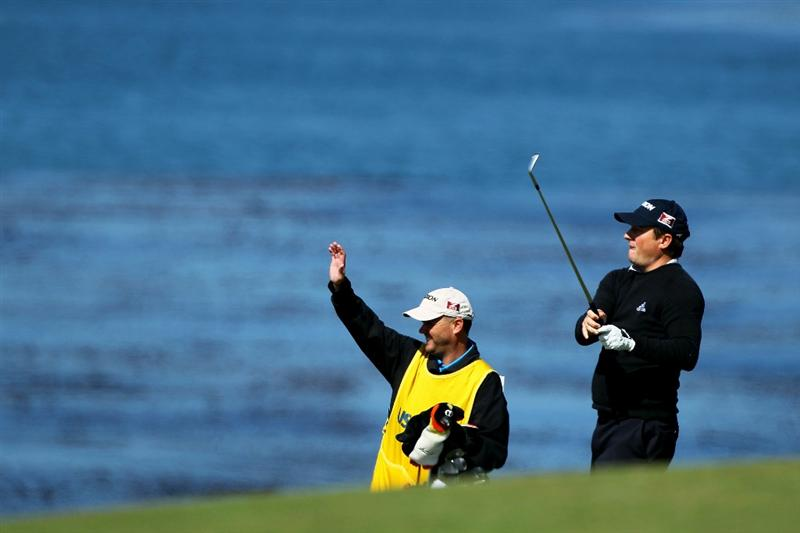 PEBBLE BEACH, CA - JUNE 17:  Tim Clark of South Africa watches his shot on the eighth hole with his caddie Steve Underwood during the first round of the 110th U.S. Open at Pebble Beach Golf Links on June 17, 2010 in Pebble Beach, California.  (Photo by Donald Miralle/Getty Images)