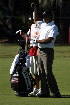 LAKE BUENA VISTA, FL - NOVEMBER 07:  Marc Turnesa selects a club on the second hole during the secind round at the Childrens Miracle Network Classic at Disney Palm on November 7, 2008 in Lake Buena Vista, Florida. (Photo by Marc Serota/Getty Images)