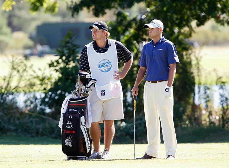 MADISON, MS - OCTOBER 03: Bill Haas (R) stands by his bag on the ninth fairway during the final round of the Viking Classic held at Annandale Golf Club on October 3, 2010 in Madison, Mississippi.  (Photo by Michael Cohen/Getty Images)