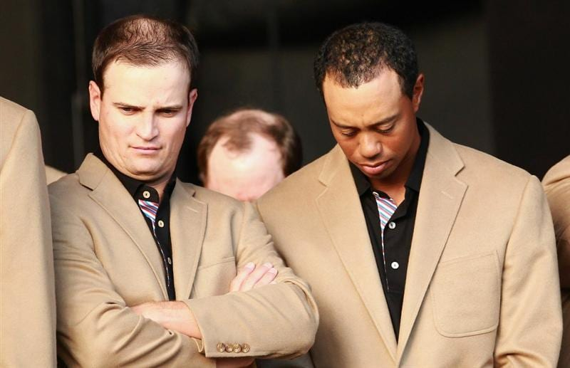 NEWPORT, WALES - OCTOBER 04: (L-R) Team USA members Zach Johnson and Tiger Woods show dejection during the closing ceremonies of the 2010 Ryder Cup at the Celtic Manor Resort on October 4, 2010 in Newport, Wales. (Photo by Andrew Redington/Getty Images)
