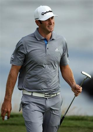 PEBBLE BEACH, CA - JUNE 19:  Dustin Johnson walks off the tenth green during the third round of the 110th U.S. Open at Pebble Beach Golf Links on June 19, 2010 in Pebble Beach, California.  (Photo by Donald Miralle/Getty Images)