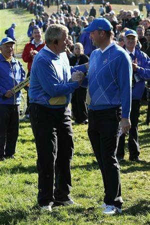 NEWPORT, WALES - OCTOBER 04:  The European Team Captain Colin Montgomerie encourages Peter Hanson in the singles matches during the 2010 Ryder Cup at the Celtic Manor Resort on October 4, 2010 in Newport, Wales.  (Photo by David Cannon/Getty Images)