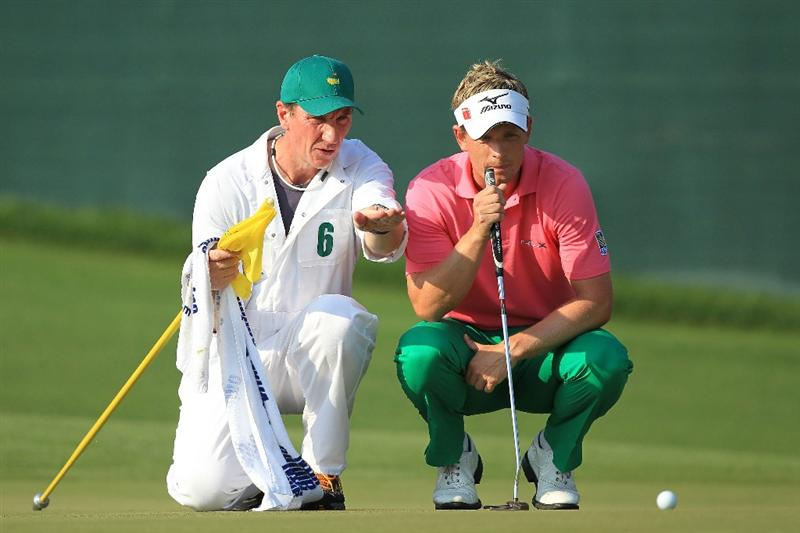 AUGUSTA, GA - APRIL 09:  Luke Donald of England (R) and caddie John McLaren line up a putt on the 17th green during the third round of the 2011 Masters Tournament at Augusta National Golf Club on April 9, 2011 in Augusta, Georgia.  (Photo by David Cannon/Getty Images)