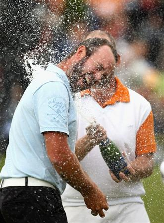ST OMER, FRANCE - JUNE 21:  Christian Nilsson of Sweden is sprayed with champagne after winning the Open de St Omer at the AA St Omer Golf Club on June 21, 2009 in St Omer, France.  (Photo by Ryan Pierse/Getty Images)