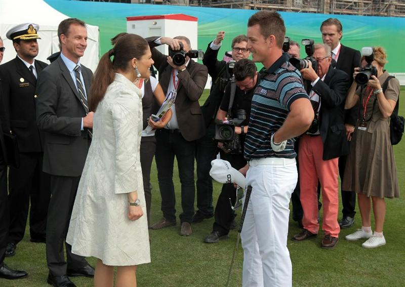 ABU DHABI, UNITED ARAB EMIRATES - JANUARY 20: Princess Victoria of Sweden accompanied by the Sewdish Ambassador to The UAE Mr Magnus Scholdtz (beside the princess) meet star professional golfer Henrik Stenson of Sweden before he teed off in the first round of the 2011 Abu Dhabi HSBC Golf Championship to be held at the Abu Dhabi Golf Club on January 20, 2011 in Abu Dhabi, United Arab Emirates.  (Photo by David Cannon/Getty Images)