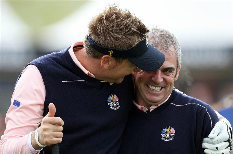 NEWPORT, WALES - SEPTEMBER 30:  Vice captain Paul McGinley (R) and Ian Poulter of Europe walk off a tee box during a practice round prior to the 2010 Ryder Cup at the Celtic Manor Resort on September 30, 2010 in Newport, Wales.  (Photo by Ross Kinnaird/Getty Images)