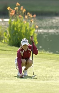 Natalie Gulbis lines up a putt on the 13th green during the first round of the Safeway Classic at Columbia-Edgewater Country Club in Portland, Oregon on August 18, 2006.Photo by Al Messerschmidt/WireImage.com