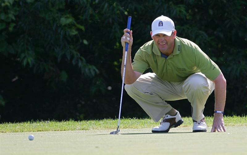 SILVIS, IL - JULY 11:  Lee Janzen of the USA lines up a putt during the continuation of the second round of the John Deere Classic at TPC Deere Run held on July 11, 2009 in Silvis, Illinois.  (Photo by Michael Cohen/Getty Images)