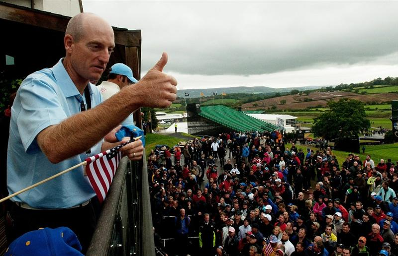 NEWPORT, WALES - OCTOBER 01:  Jim Furyk of the USA gestures to fans as play is suspended during the Morning Fourball Matches during the 2010 Ryder Cup at the Celtic Manor Resort on October 1, 2010 in Newport, Wales.  (Photo by PGA of America/Getty Images)