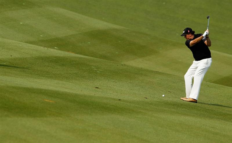 SHANGHAI, CHINA - NOVEMBER 06:  Phil Mickelson of the USA hits his approach shot on the fourth hole during the third round of the HSBC Champions at the Sheshan Golf Club on November 6, 2010 in Shanghai, China.  (Photo by Scott Halleran/Getty Images)