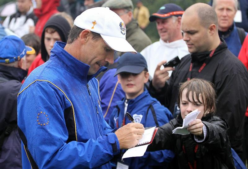 NEWPORT, WALES - SEPTEMBER 29:  Padraig Harrington of Europe signs autographs during a practice round prior to the 2010 Ryder Cup at the Celtic Manor Resort on September 29, 2010 in Newport, Wales.  (Photo by Andy Lyons/Getty Images)