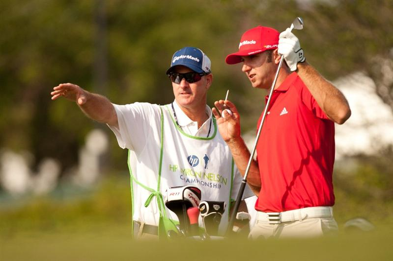 IRVING, TX - MAY 28: Dustin Johnson and caddie Joe LaCava discuss a shot during the third round of the HP Byron Nelson Championship at TPC Four Seasons at Las Colinas on May 28, 2011 in Irving, Texas. (Photo by Darren Carroll/Getty Images)