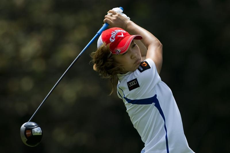 CHON BURI, THAILAND - FEBRUARY 19:  Momoko Ueda of Japan tees off on the 9th hole during round two of the Honda LPGA Thailand at the Siam Country Club on February 19, 2010 in Chon Buri, Thailand.  (Photo by Victor Fraile/Getty Images)