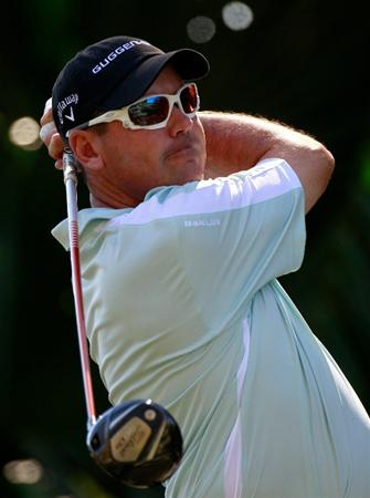 LAKE BUENA VISTA, FL - NOVEMBER 11:  Rich Beem plays a shot on the 15th hole during the first round of the Children's Miracle Network Classic at the Disney Palm and Magnolia courses on November 11, 2010 in Lake Buena Vista, Florida.  (Photo by Sam Greenwood/Getty Images)