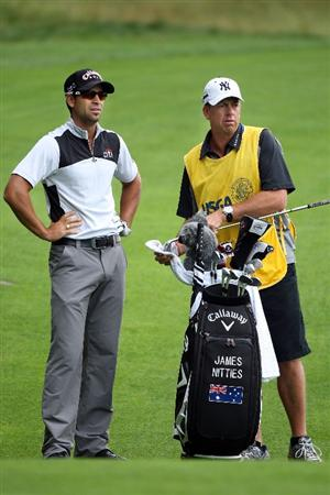 FARMINGDALE, NY - JUNE 20:  James Nitties of Australia waits with his caddie Steve Potts on the ninth hole during the continuation of the second round of the 109th U.S. Open on the Black Course at Bethpage State Park on June 20, 2009 in Farmingdale, New York.  (Photo by Andrew Redington/Getty Images)