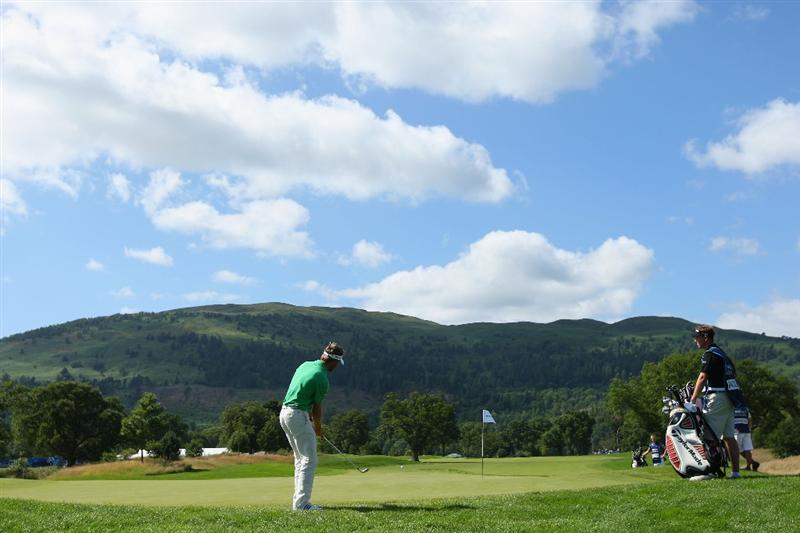 LUSS, UNITED KINGDOM - JULY 10:   Raphael Jacquelin of France chips onto the 1st green during the Second Round of The Barclays Scottish Open at Loch Lomond Golf Club on July 10, 2009 in Luss, Scotland. (Photo by Andrew Redington/Getty Images)
