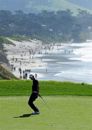 PEBBLE BEACH, CA - FEBRUARY 14:  Dustin Johnson reacts to his putt on the nineth hole during the final round of the AT&T Pebble Beach National Pro-Am at Pebble Beach Golf Links on February 14, 2010 in Pebble Beach, California.  (Photo by Stuart Franklin/Getty Images)