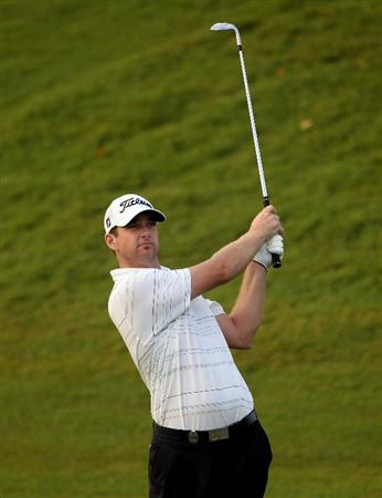 KUALA LUMPUR, MALAYSIA - MARCH 04:  Marcus Both of Australia plays his third shot on the tenth hole during the first round of the Maybank Malaysian Open at the Kuala Lumpur Golf and Country Club on March 4, 2010 in Kuala Lumpur, Malaysia.  (Photo by Andrew Redington/Getty Images)