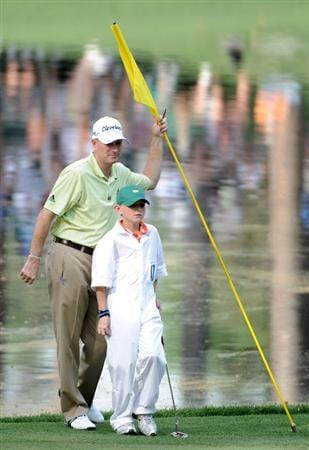 AUGUSTA, GA - APRIL 07:  Steve Flesch looks on with his caddie/son Griffen during the Par 3 Contest prior to the 2010 Masters Tournament at Augusta National Golf Club on April 7, 2010 in Augusta, Georgia.  (Photo by Harry How/Getty Images)