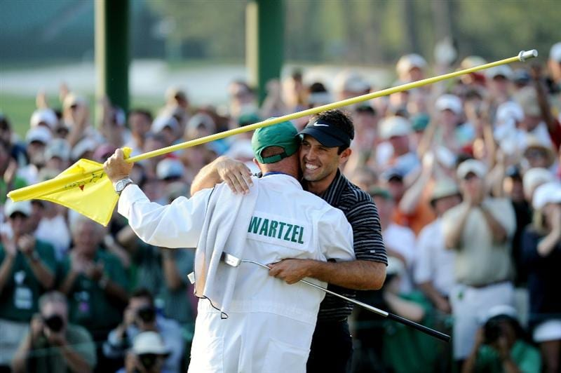 AUGUSTA, GA - APRIL 10:  Charl Schwartzel of South Africa celebrates his two-stroke victory with his caddie Greg Hearmon on the 18th green during the final round of the 2011 Masters Tournament at Augusta National Golf Club on April 10, 2011 in Augusta, Georgia.  (Photo by Harry How/Getty Images)