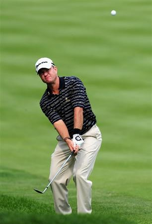 AKRON, OH - AUGUST 06:  Scott Verplank of the U.S. plays his chip shot on the seventh hole during the first round of the World Golf Championship Bridgestone Invitational on August 6, 2009 at Firestone Country Club in Akron, Ohio.  (Photo by Stuart Franklin/Getty Images)