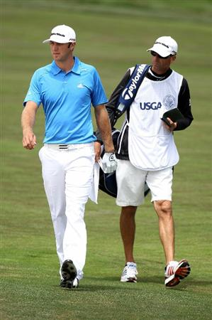 PEBBLE BEACH, CA - JUNE 20:  Dustin Johnson and his caddie Bobby Brown discuss a shot on the third hole during the final round of the 110th U.S. Open at Pebble Beach Golf Links on June 20, 2010 in Pebble Beach, California.  (Photo by Ross Kinnaird/Getty Images)