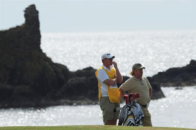 TURNBERRY, SCOTLAND - JULY 16:  Miguel Angel Jimenez of Spain lines up a shot with caddy Henrik Karlsson on the 10th hole during round one of the 138th Open Championship on the Ailsa Course, Turnberry Golf Club on July 16, 2009 in Turnberry, Scotland.  (Photo by Stuart Franklin/Getty Images)