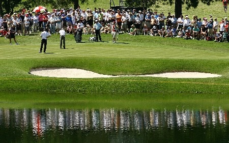 SYDNEY, AUSTRALIA - DECEMBER 14: The crowd surround the fourth hole as John Senden, Aaron Badley of Australia and Michael Campbell of New Zealand finish putting during round two of the Australian Open Championship at The Australian Golf Club on December 14, 2007 in Sydney, Australia.  (Photo by Mark Nolan/Getty Images)