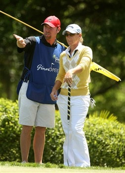 REUNION, FLORIDA - APRIL 17:  Kristy McPherson (R) chats with her caddie on the 17th green during the first round of the Ginn Open at Reunion Resort April 17, 2008 in Reunion, Florida.  (Photo by Scott Halleran/Getty Images)