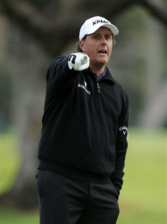 PACIFIC PALISADES, CA - FEBRUARY 18:  Phil Mickelson directs people on the second hole during the second round of the Northern Trust Open at the Riviera Country Club on February 18, 2011 in Pacific Palisades, California.  (Photo by Harry How/Getty Images)