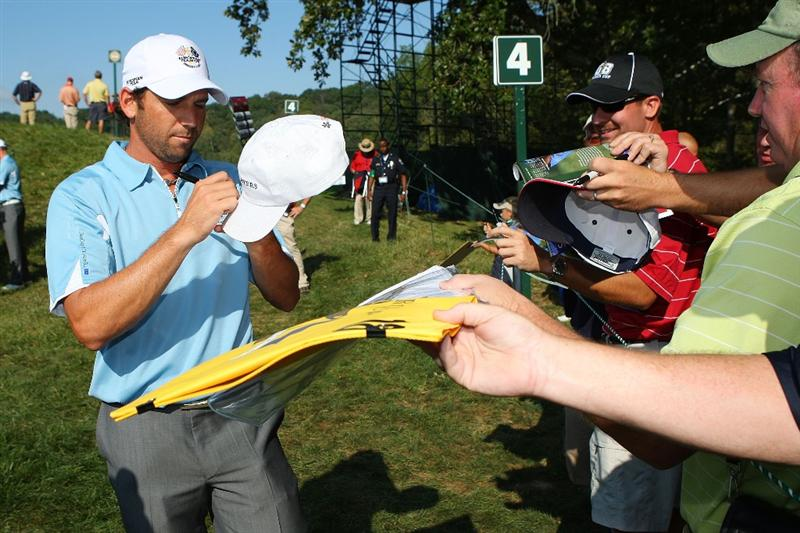 LOUISVILLE, KY - SEPTEMBER 16:  Sergio Garcia of the European team signs autographs for fans during his practice round prior to the start of the 2008 Ryder Cup at Valhalla Golf Club on September 16, 2008 in Louisville, Kentucky.  (Photo by Andrew Redington/Getty Images)